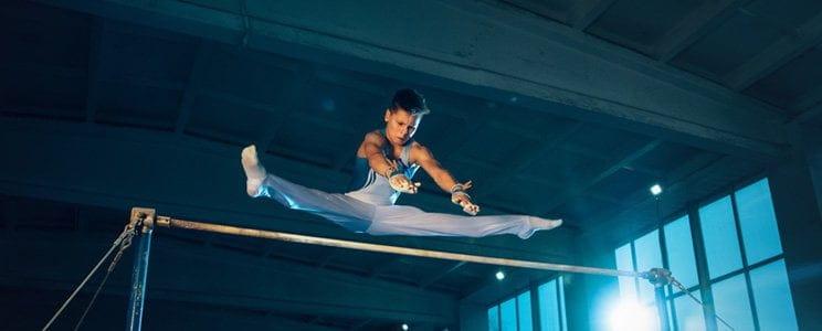 gymnasts training bar